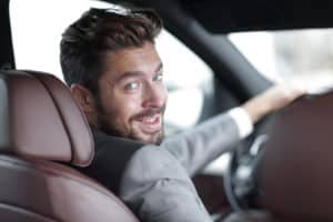 Male driving while turned around
